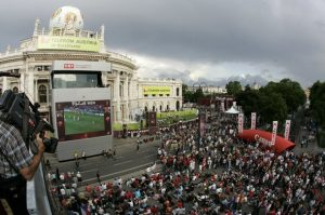 A cameraman films the official EURO 2008 fan zone in front of Vienna's Burgtheater June 7, 2008. (EURO 2008 Preview)  REUTERS/Herwig Prammer (AUSTRIA)